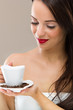 woman enjoys at morning coffee
