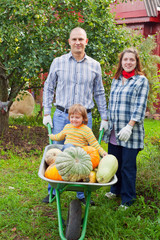 Happy parents and child with  harvest