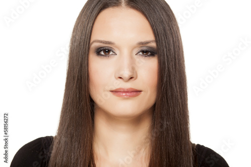 portrait of beautiful girl posing on white background