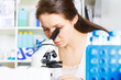 student girl and microscope in laboratory