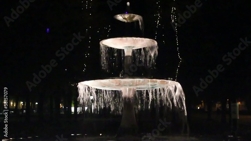 Fountain at night in the light illumination