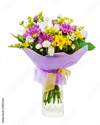 Colorful bouquet from gerbera flowers in glass vase isolated