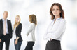 Confident businesswoman background with her colleagues
