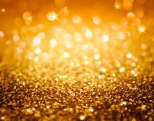 Złoty brokat i gwiazdki na Boże Narodzenie tle