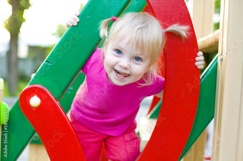 Attractive baby at a playground in the summer