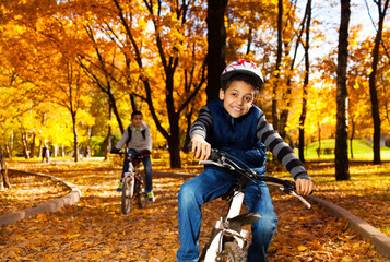 Boy on bike ride with brother