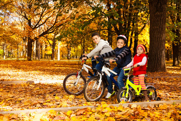 Group of kids riding in autumn park