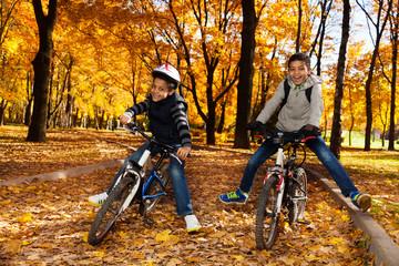 Boys ride bikes in the park