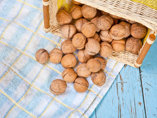 walnuts on the table in an inverted wicker basket