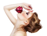 sensual woman with red rose in mouth