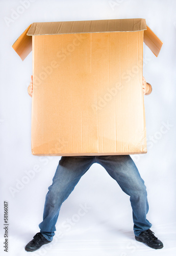 boy carries huge box. transportation concept