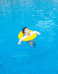 baby boy Activities on the pool, children swimming