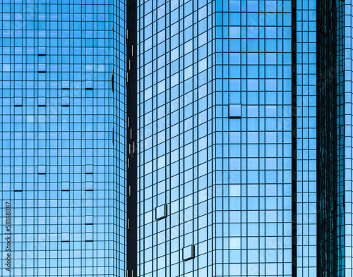 facade of skyscraper with sun reflections