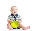 baby with a spoon and plate