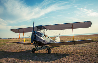 Biplane - vintage aircraft on airfield