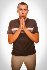 man male brunette prays Christianity hands together