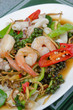 stir fried seafood on white dish