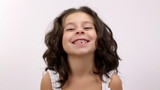 A cute young girl do happy facial expression