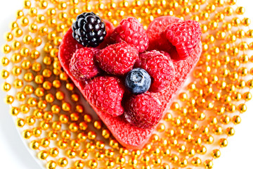 Heart shaped cake with berries on top