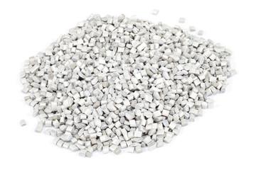 grey plastic polymer granules on white background