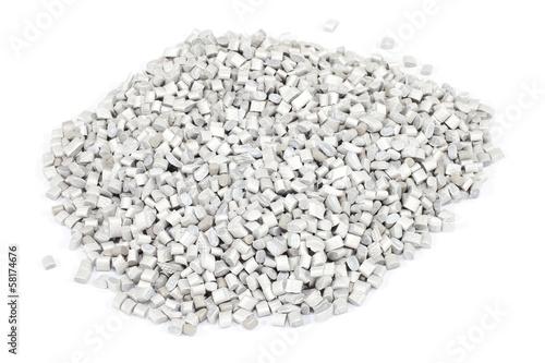 grey plastic polymer granules on white background - 58174676