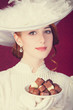 Beautiful redhead women with candy.
