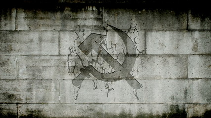 Hammer and Sickle appearing on a wall