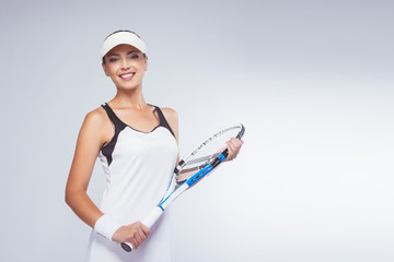 Young Smiling Woman With Tennis Racket
