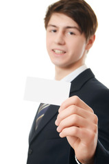 The businessman in a business suit with visiting card