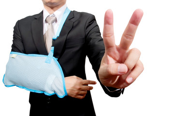 thumb up young businessman with broken hand wearing an arm brace