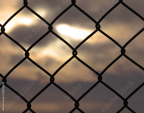 Abstract sunset through fence