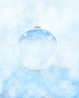 glass christmas ball on holiday background