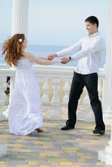 beautiful young couple in love near the sea