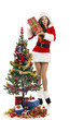 Sexy Santa girl holding gift near Christmas tree over white.