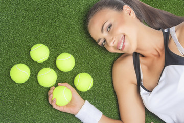 Portrait of Smiling and Happy Female Sportswoman Lying on Artifi