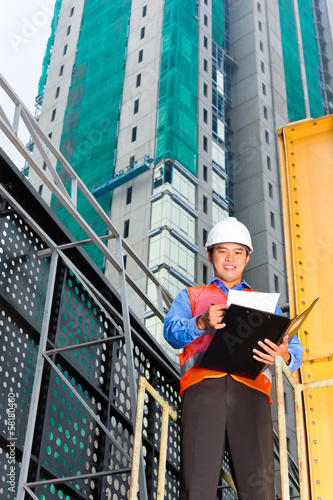 Asian worker or supervisor on building site