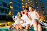 Chinese couples drinking cocktails in hotel pool bar - 58180802