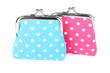 Blue and pink purses isolated on white