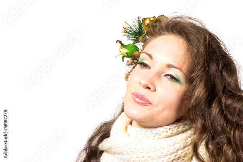 Young and beautiful womans portrair in winter dress isolated on