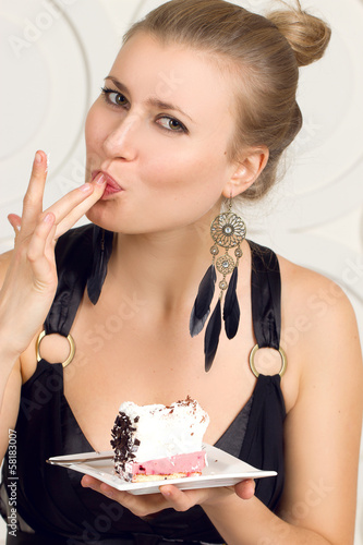 Girl eating cake with his hands