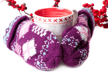 Cozy red gloves hold a mug