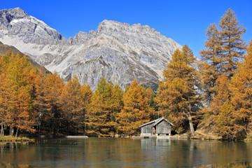 çog cabins by Palpuogna Lake in Engadina, Switzerland