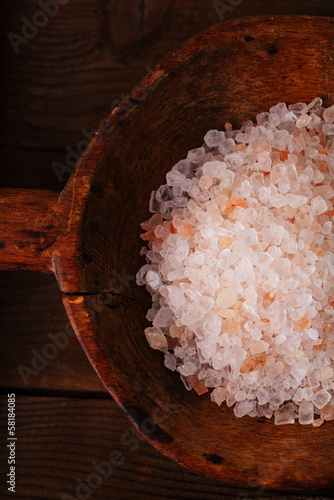 Pink Crystal Rock salt in rustic wooden spoons