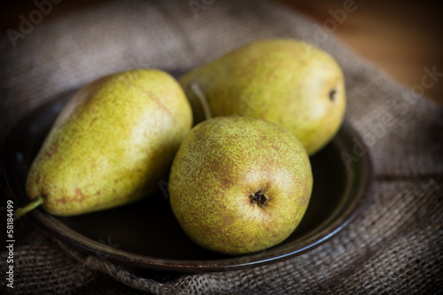 Fresh ripe pears on natural background.