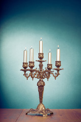 Vintage brass candelabrum with five burning candles