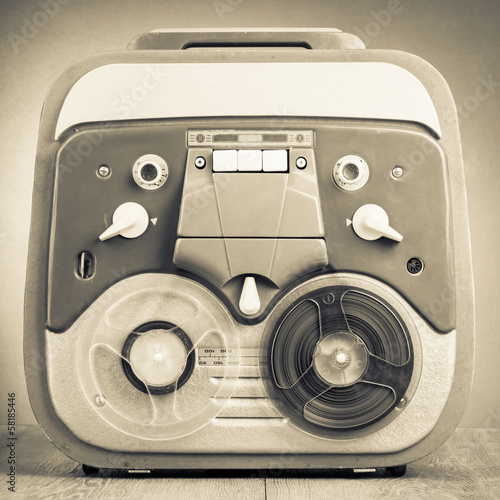 Retro reel to reel tape recorder old sepia photo