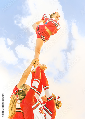 Young cheerleader balancing toward the Sky - Cheerleaders Team