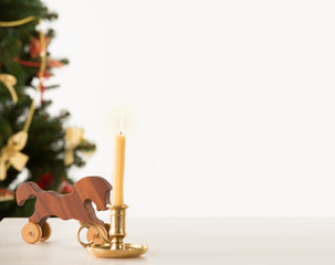 Vintage Wooden Horse on Santa's work table, Christmas Tree on ba