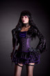 Romantic gothic girl in purple and black outfit