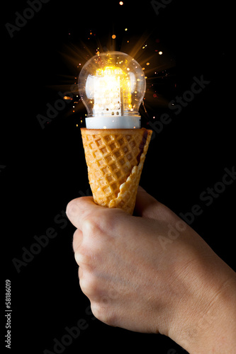 hand holding led lamp in ice cream cone
